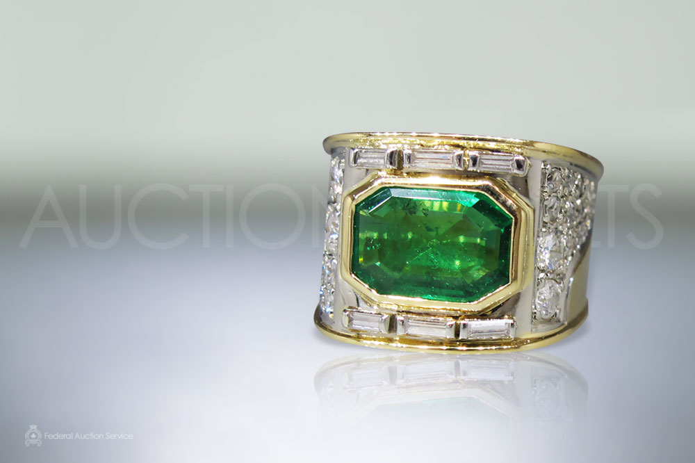 Lady's 18k Yellow/White Gold Emerald and Diamond Ring sold for $4,600