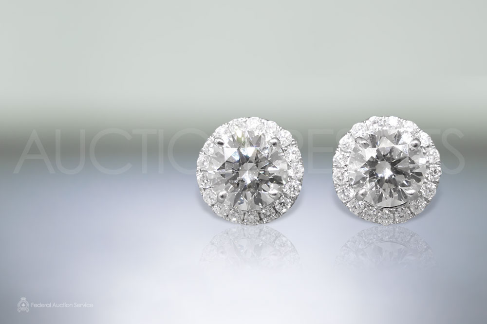 A Pair of EGL Certified 2.24ct Round Brilliant Cut Diamond Earrings sold for $12,500