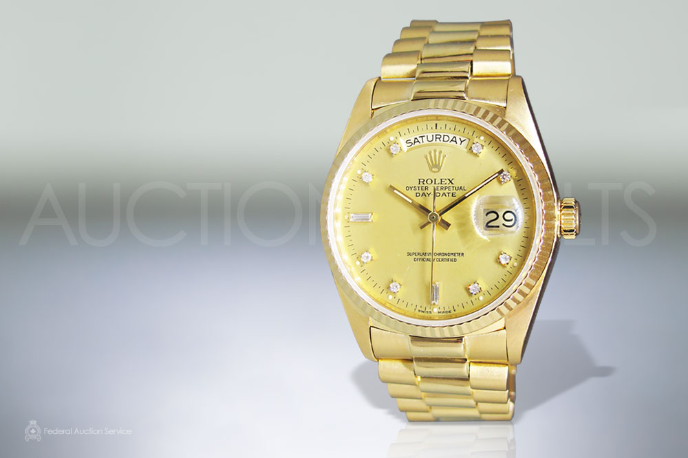 Men's 18k Yellow Gold Rolex Day-Date Automatic Wristwatch sold for $19,000