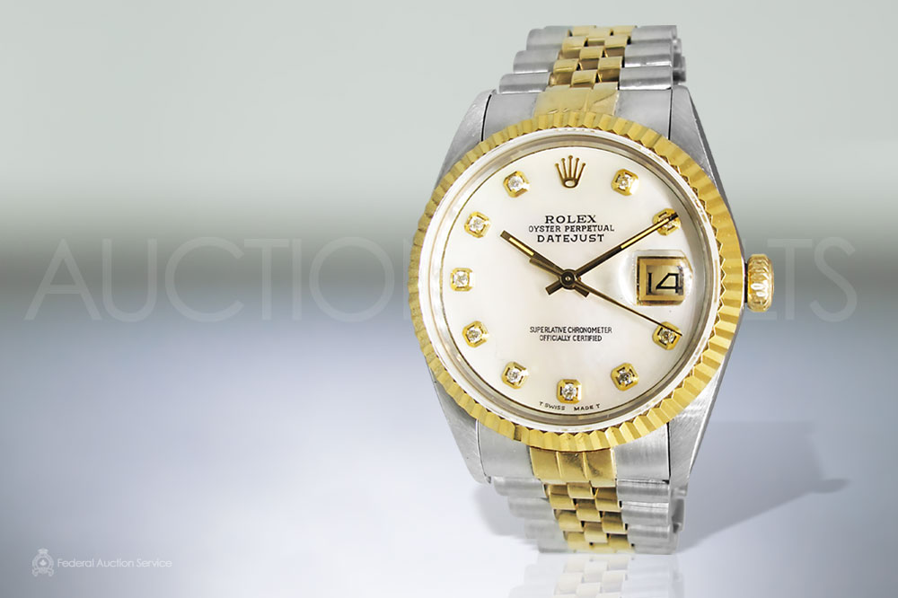 Men's 18k Stainless Steel and Yellow Gold Two Tone Rolex Datejust Automatic Wristwatch Sold For $6,200