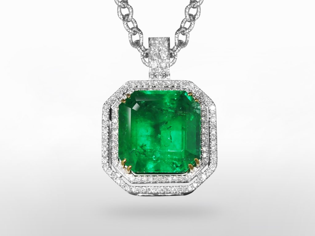 Lady's 18k White and Yellow Gold 36.99ct Rectangular Step Cut Emerald and Diamond Pendant Necklace