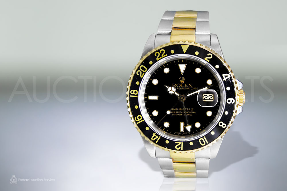 Men's 18k Yellow Gold/Stainless Steel Rolex 'GMT-Master II' Automatic Chronometer sold for $10,000