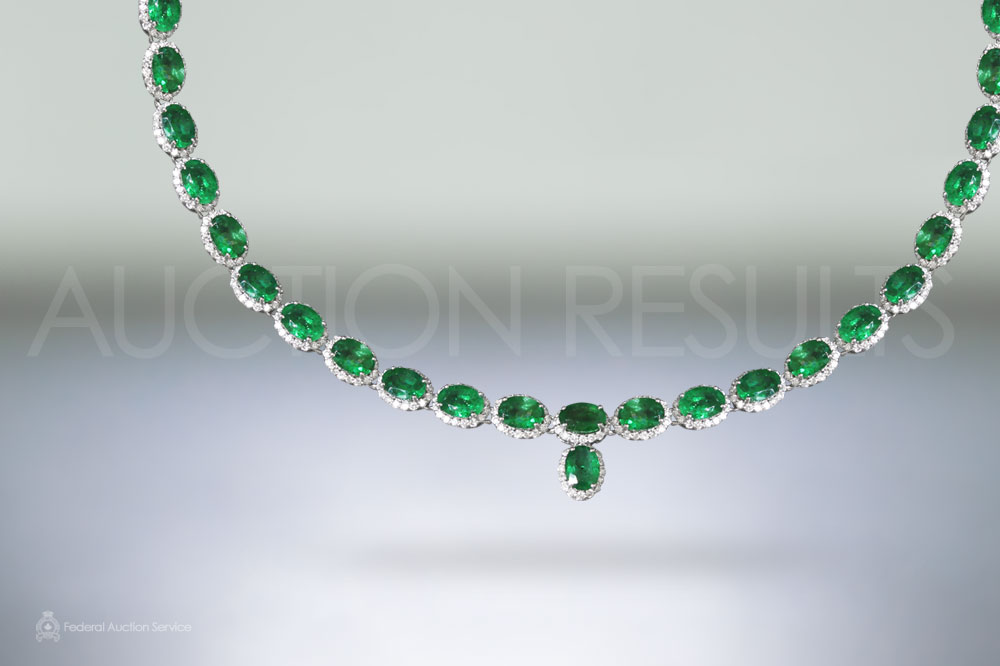 33.78ct (TW) Oval Cut Emeralds and Diamond Necklace sold for $15,000