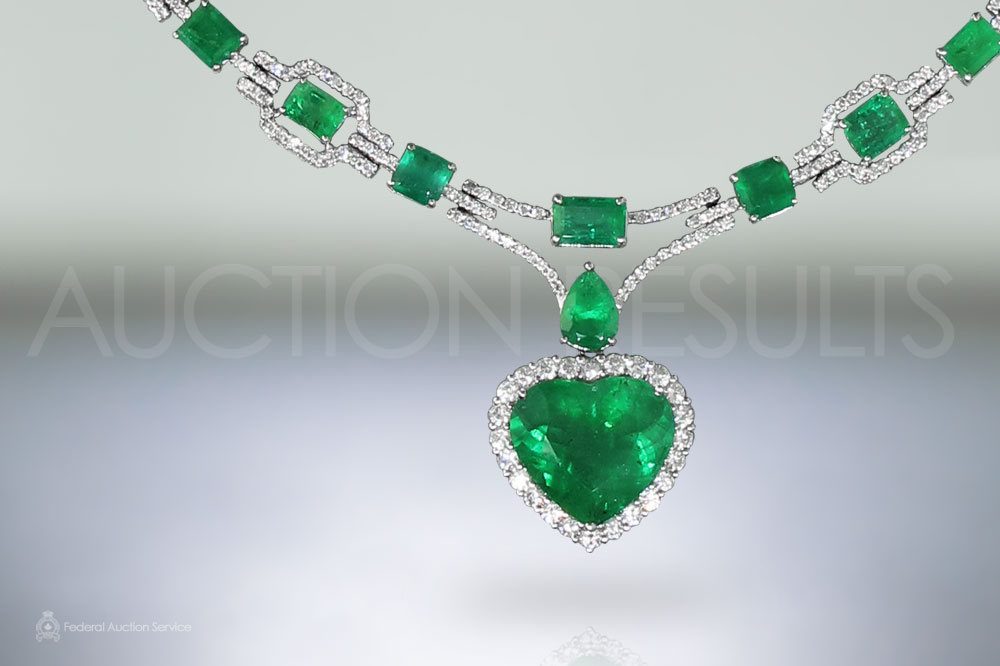 18k White Gold 26.74ct Emerald and Diamond Necklace sold for $51,000