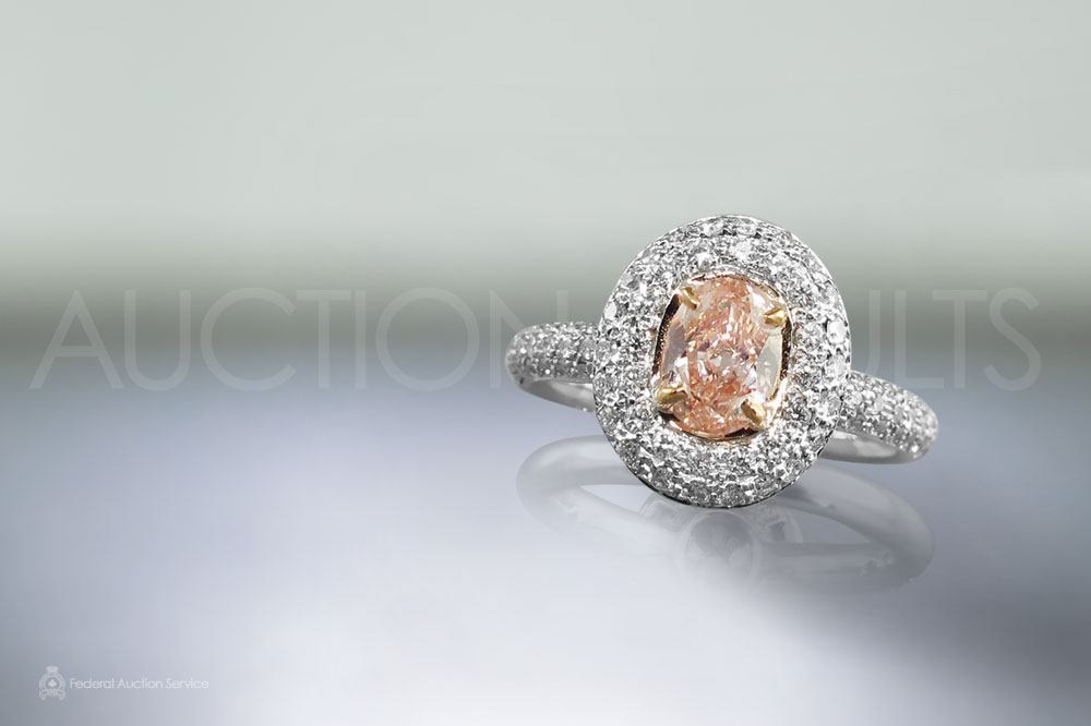 GIA Certified 0.52ct Oval Brilliant Cut Fancy Orangy Pink Diamond Ring sold for $19,400