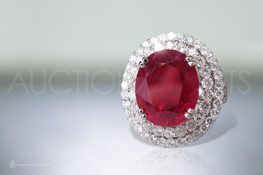 CGL Certified 7.59ct Oval Faceted Ruby and Diamond Ring sold for $10,000