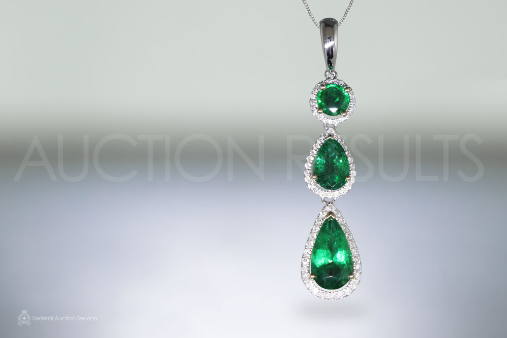 18k White Gold Emerald and Diamond Pendant sold for $4,600