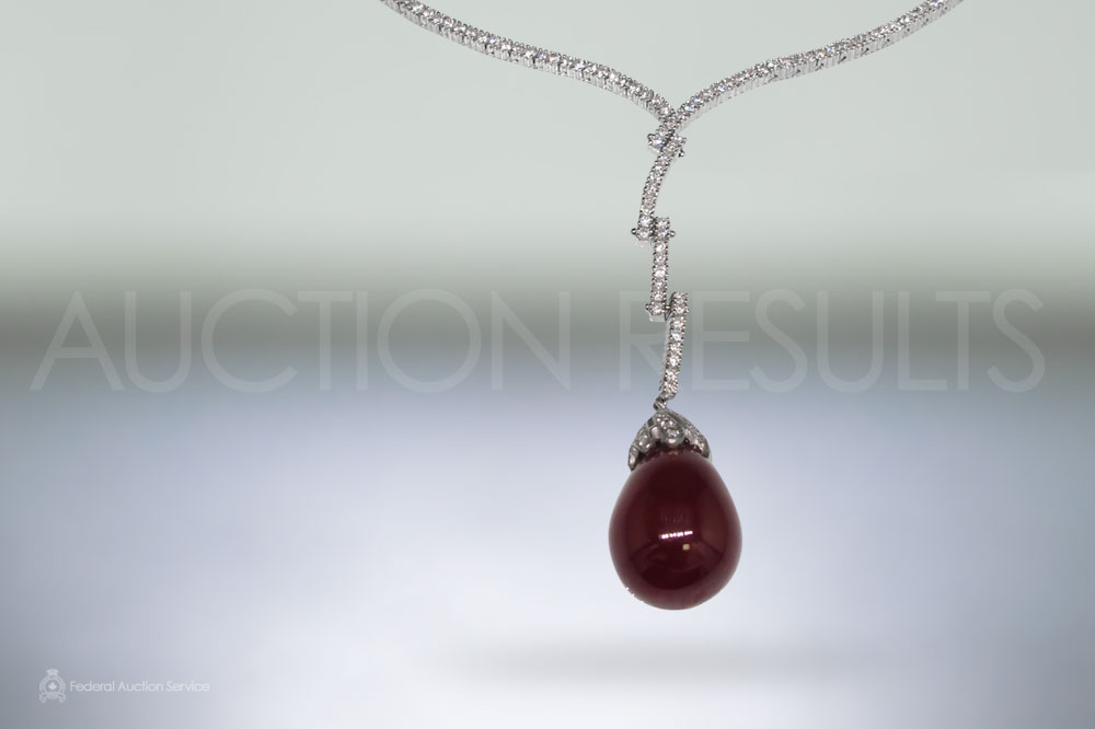 Lady's 18k White Gold Ruby and Diamond Necklace sold for $6,800