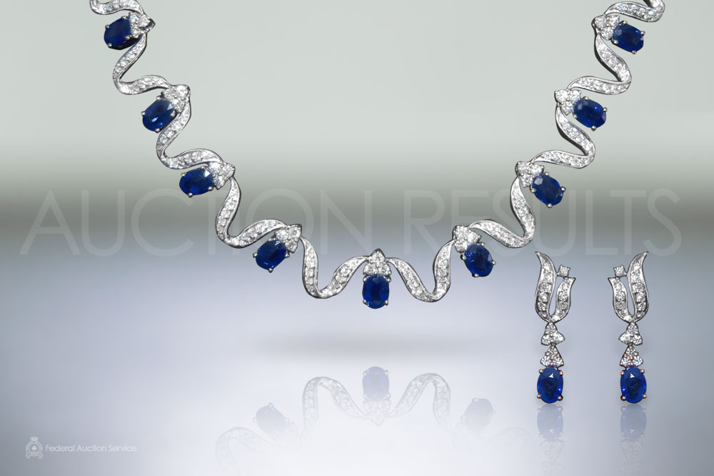 Lady's 18k White Gold Sapphire and Diamond Necklace and Matching Earrings Set sold for $26,000