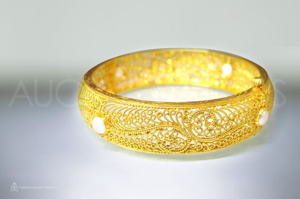 Fine Yellow Gold Hinged Bangle Stamped 22k sold for $2,300