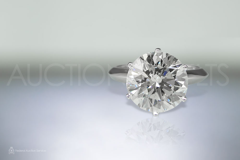 EGL Certified 5.19ct Round Brilliant Cut Diamond Ring sold for $83,000