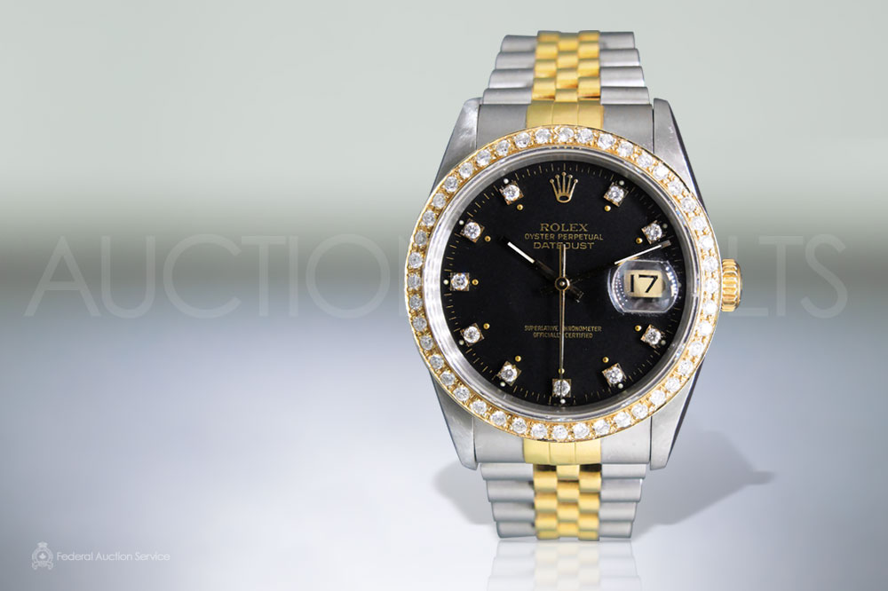 Men's Stainless Steel/18k Yellow Gold Rolex Datejust Automatic Wristwatch with Diamonds sold for $8,000