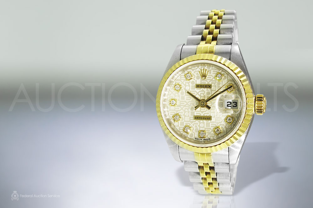 Lady's 18k Yellow Gold and Stainless Steel Rolex Datejust Automatic Wristwatch sold for $6,100