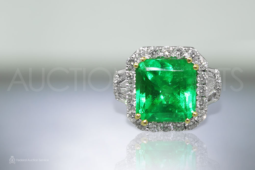 A 7.10ct Square Step Cut Colombian Emerald and Diamond Ring sold for $24,000