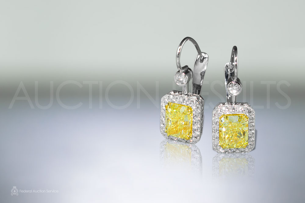 6ct Intense Yellow Diamond Earrings sold for $83,000