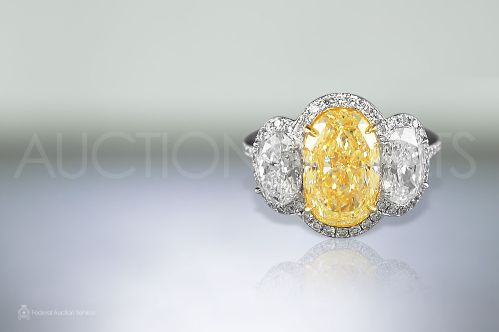 4ct Fancy Yellow with 2ct Diamond Ring sold for $60,000