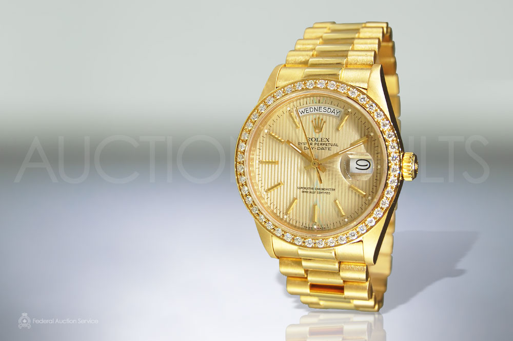 Men's 18k Yellow Gold Diamond Rolex sold for $14,000