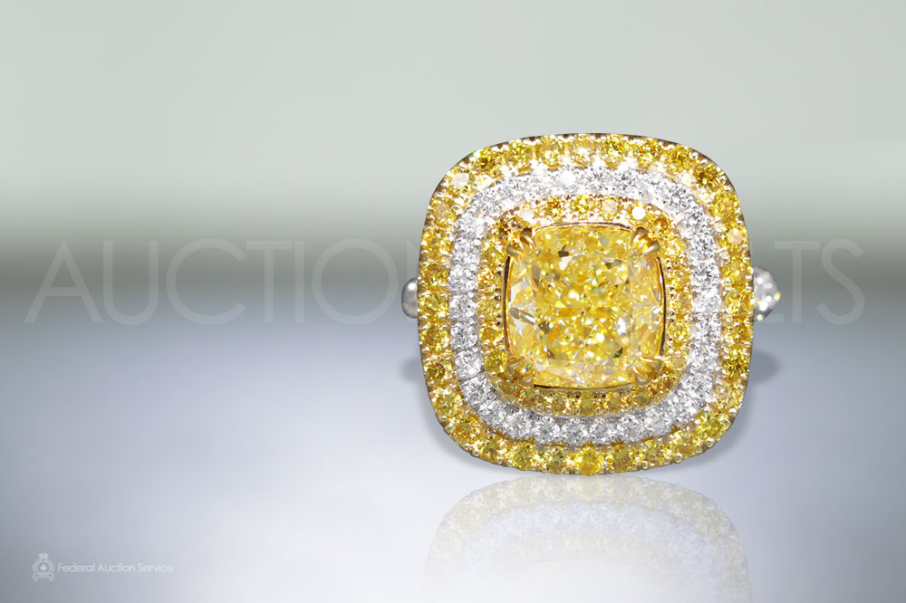 EGL Certified 3.17ct Cushion Cut Fancy Yellow Diamond Ring sold for $30,000