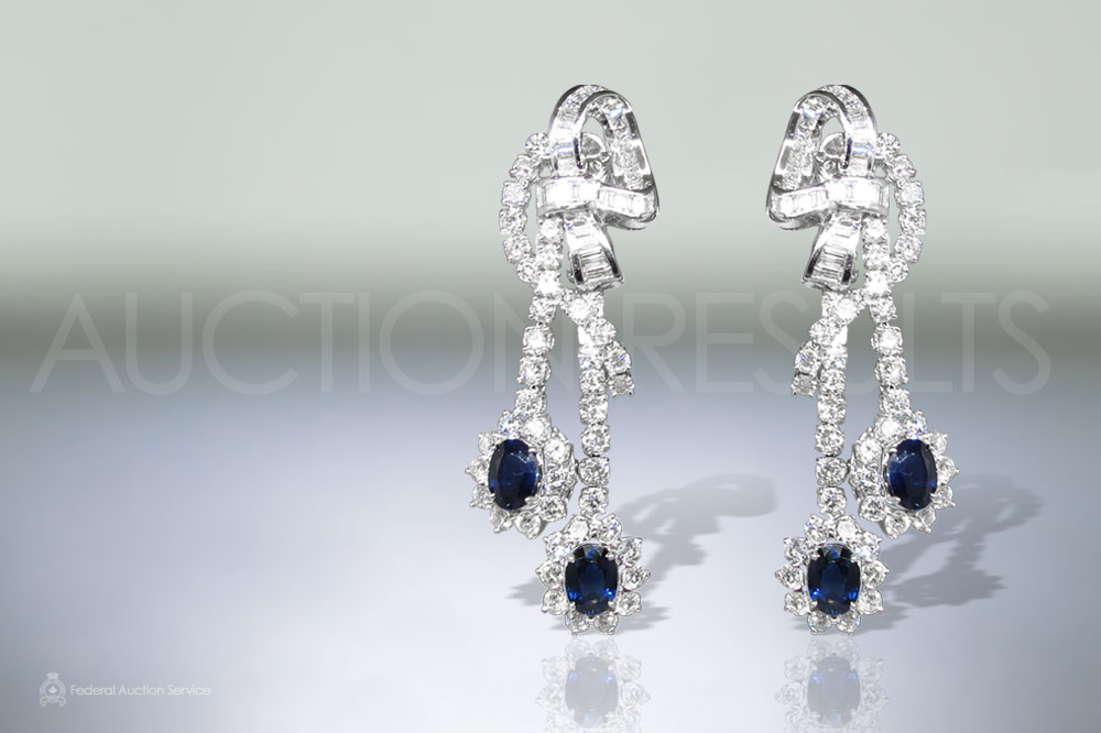 Lady's 18k White Gold Blue Sapphire and Diamond Dangling Earrings sold for $9,100