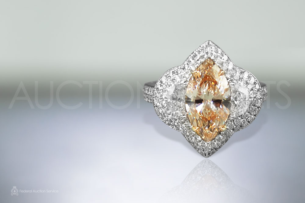 Lady's Platinum 2.08ct Fancy Orange Pink Diamond Ring sold for $26,000