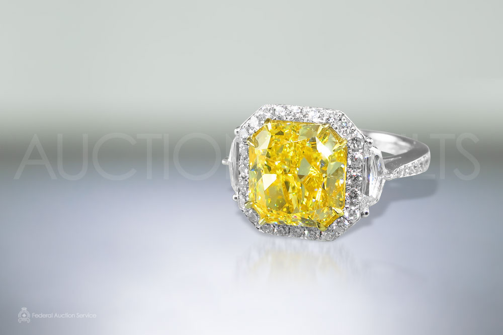 GIA Certified 5.08ct Fancy Intense Yellow, Internally Flawless Diamond Ring sold for $125,000