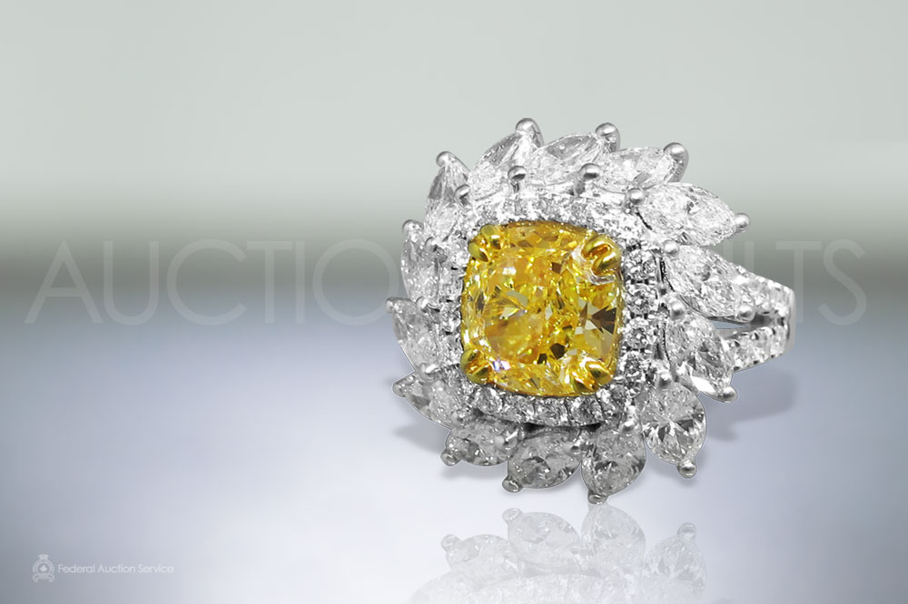EGL Certified 3.11ct Cushion Cut Fancy Vivid Yellow Diamond Ring sold for $35,000