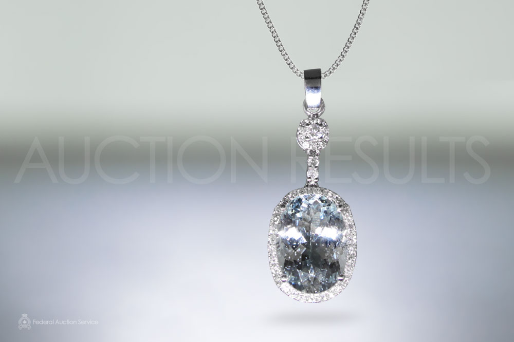 Lady's 14k White Gold Aquamarine and Diamond Pendant sold for $1,700
